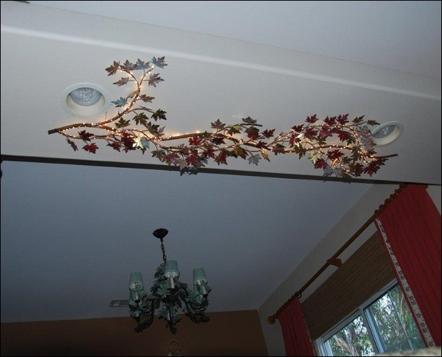 Grape Vine sculpture on a ceiling with a darker lighting.